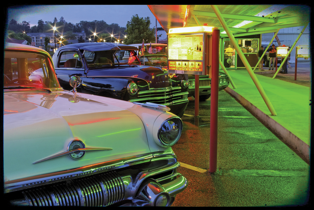 Drive-in with beaming neon lights