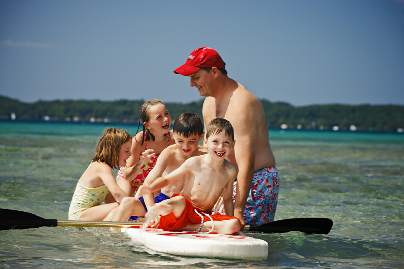 dad and kids on raft