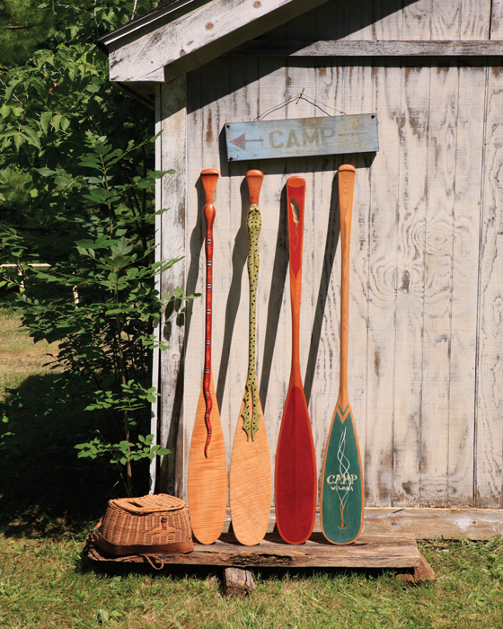 Paddles Standing Against Cabin