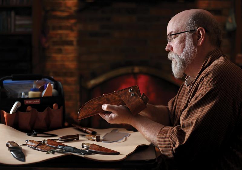Bob Braendle at his shop making knives.