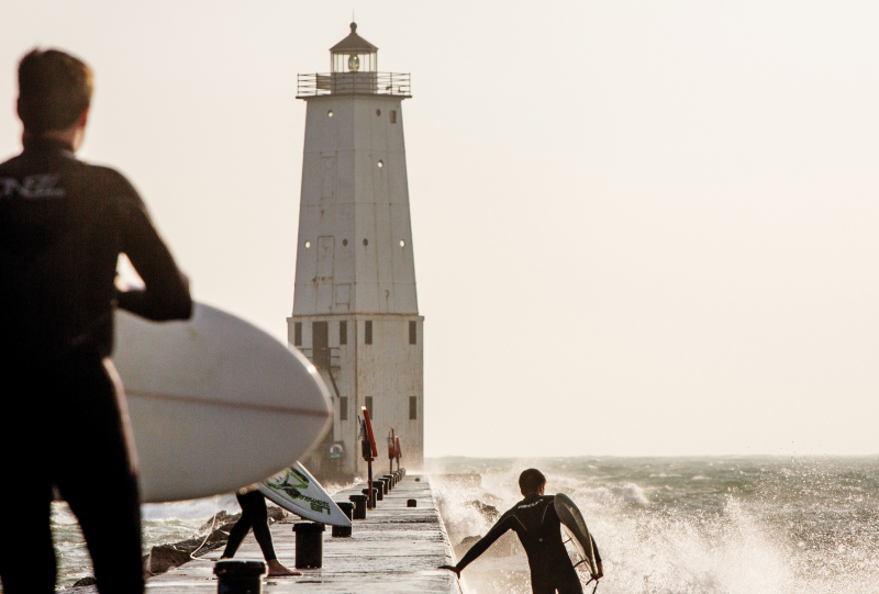 Surfers and lighthouse