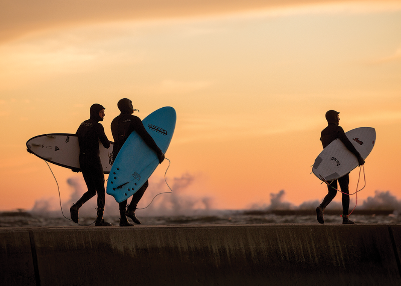 Surfers during dusk