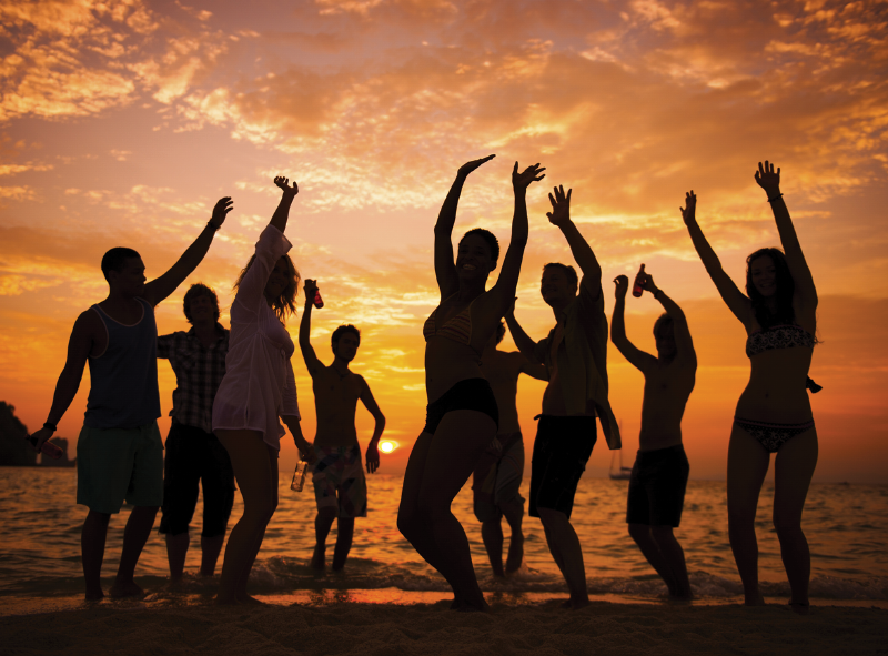 Adults partying on beach