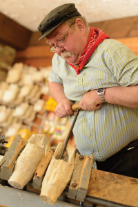 Dutch wooden shoes are carved at Dutch Village