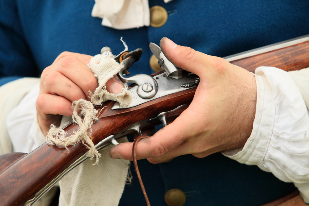 Guy cleaning a historic gun