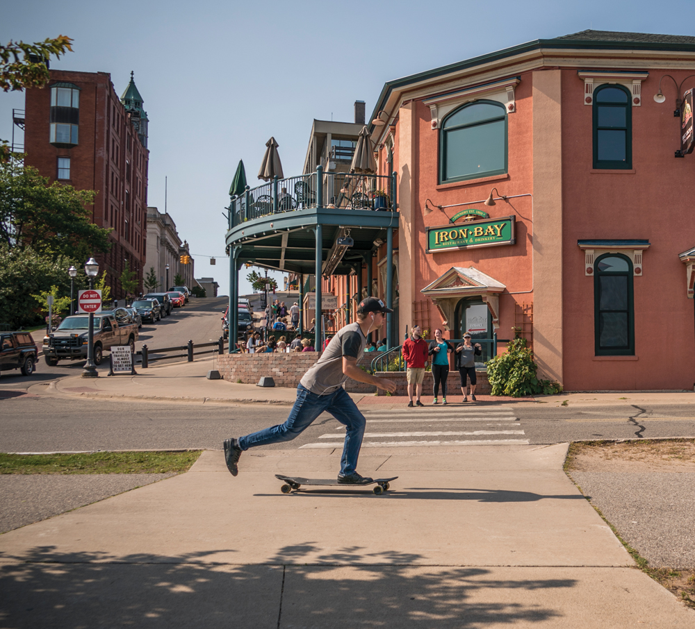Longboard skate boarder in downtown Marquette, Michigan.