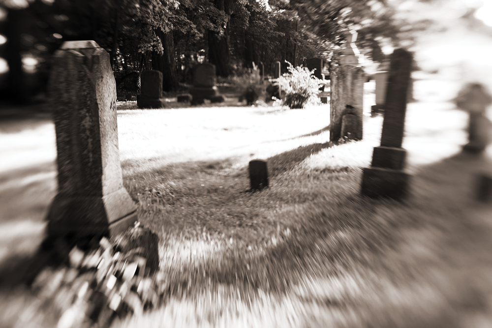 Graveyard with blurred vision