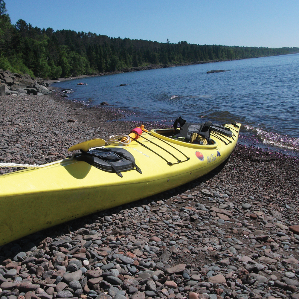 Kayak on rocky shore