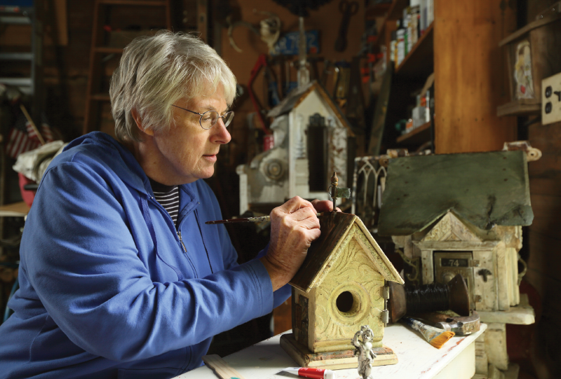 Sue Burger working on birdhouse