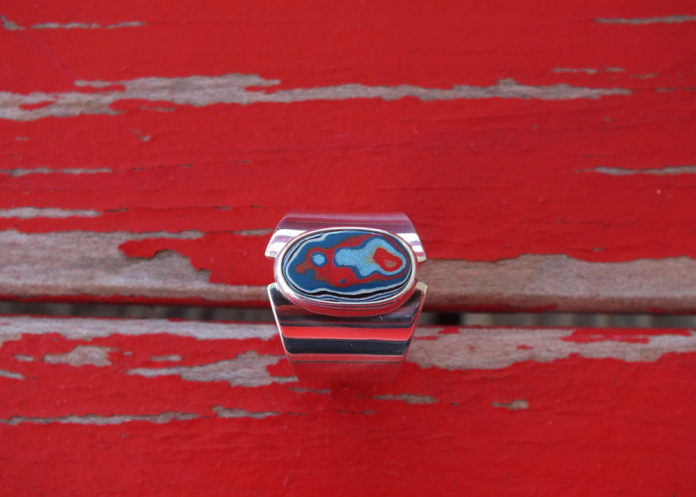 James Blanchard ring red background