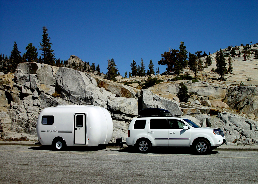 white RV in the mountains