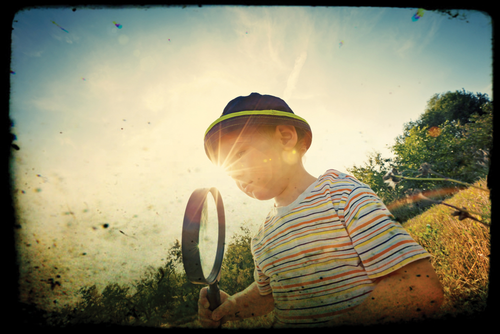 Discovery boy with magnify glass