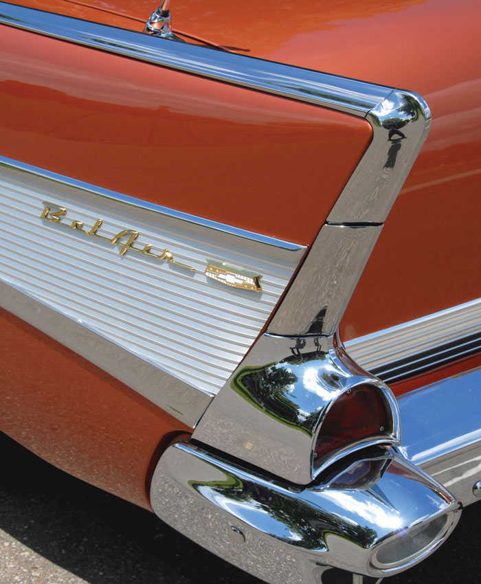 The 1957 Chevy's chrome detailing and vibrant paint colors