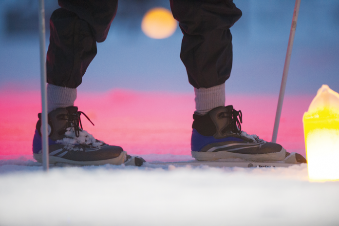 Luminarias light the way during a special night ski at Metamora-Hadley State Park.