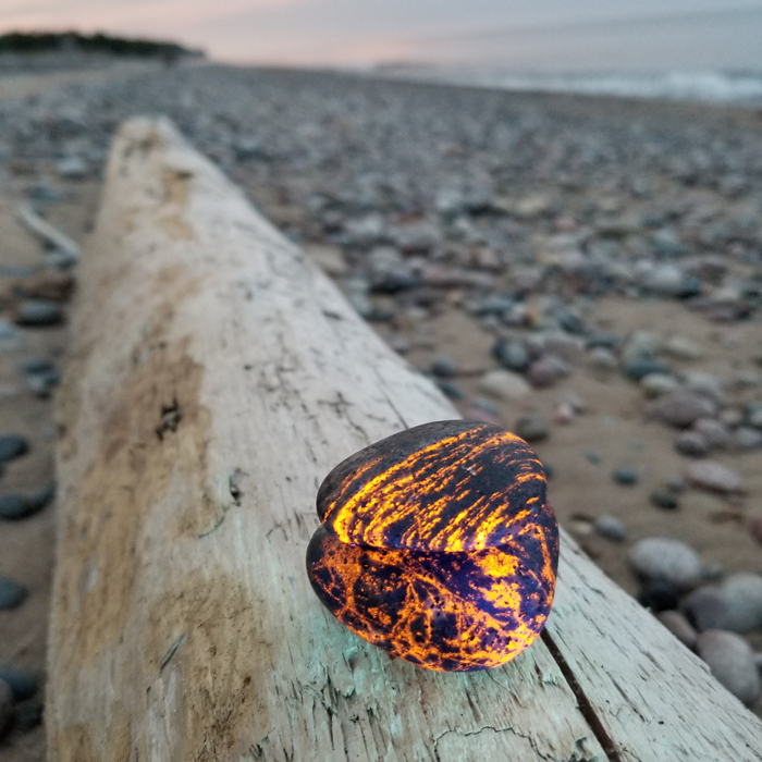 Upper Peninsula rockhound Erik Rintamaki discovered rocks that glow under ultraviolet light on a Lake Superior shoreline at night while searching for agates.