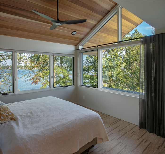 Lake-facing upstairs bedrooms provide an airy feeling of being connected to nature.