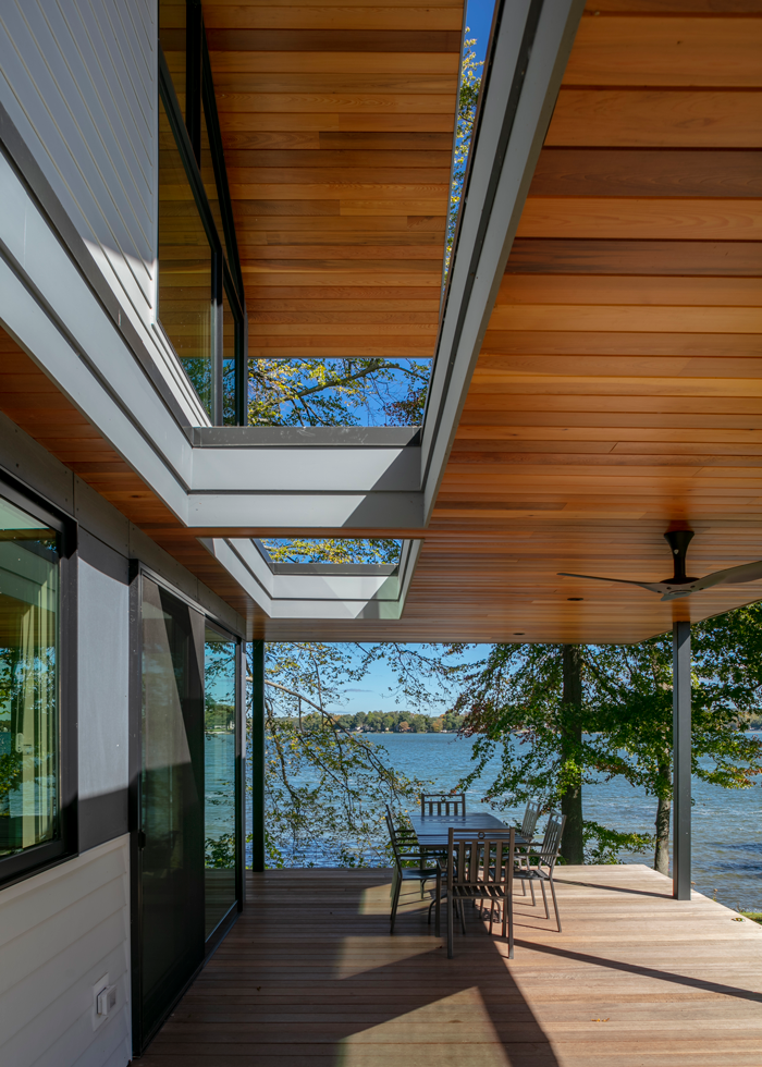 Cutouts in the flat roof provide light for the deck below.