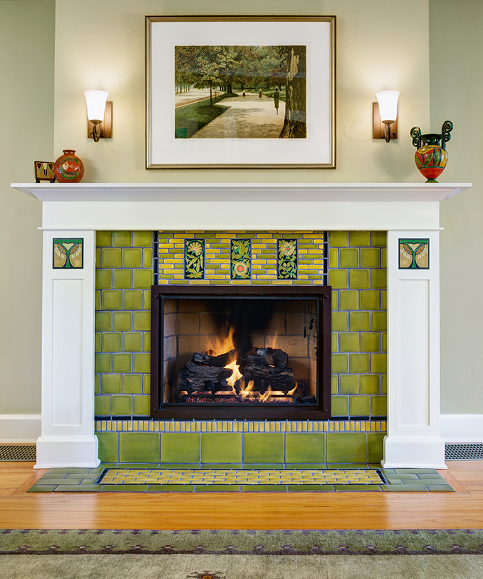 "A variety of Motawi tiles were used to create this attractive, custom ""sunflower"" fireplace facing."