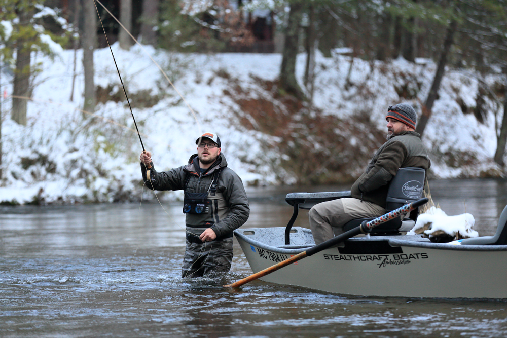 Anchoring so Shane Hensley can prospect for steelhead (rainbow trout) in a deep portion of the Pere Marquette River.