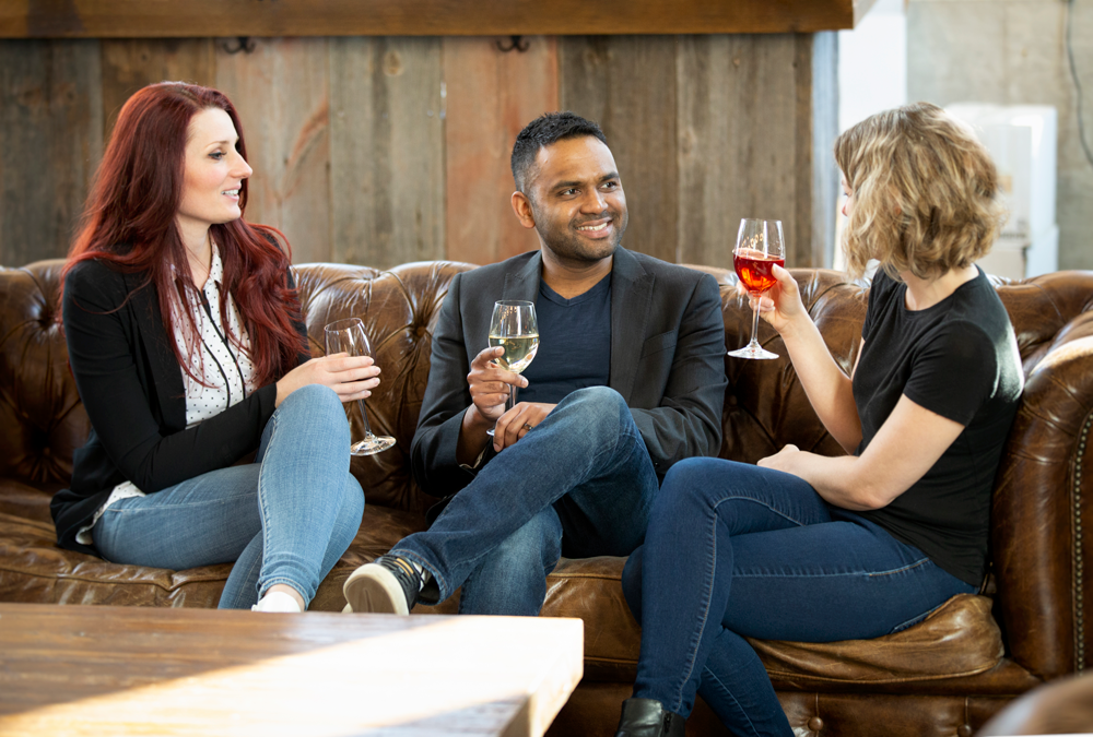 Three patrons enjoy a glass of wine in Dablon's comfortable tasting room.
