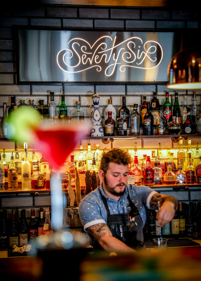Bartender Tristen Martinie mixes a special cocktail at Seventy-Six.